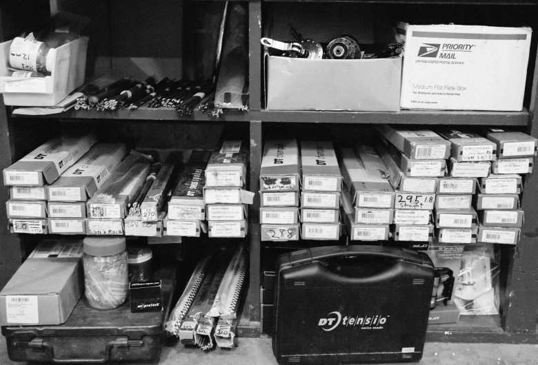 A selection of spokes rest on shelves at Wyse Cycles.
