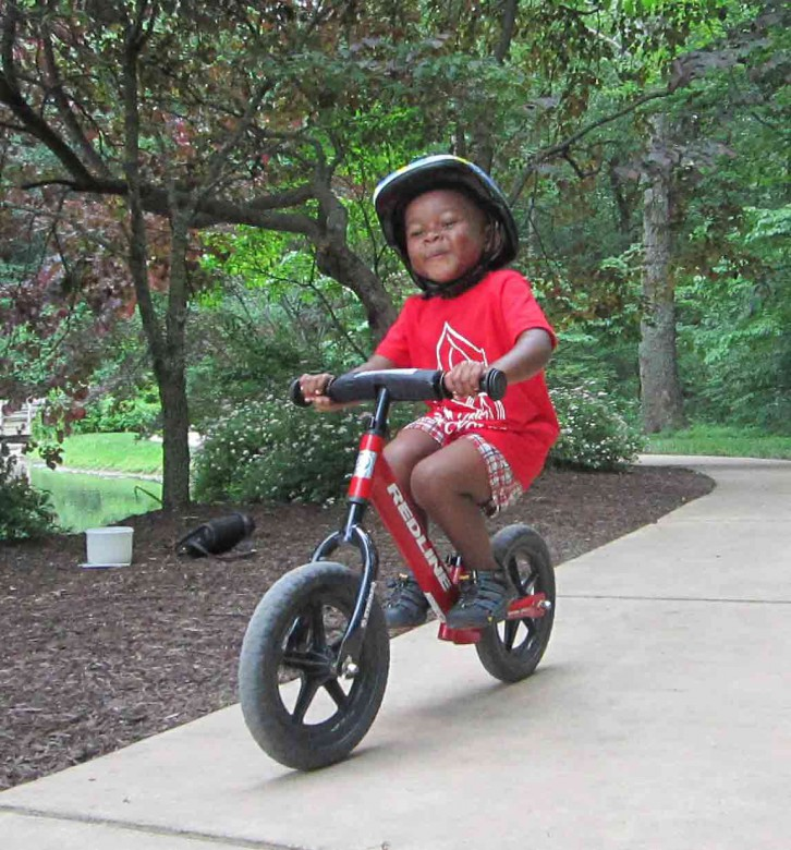 Learning to balance comes easily with a Strider balance bike.